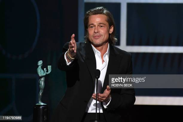 US actor Brad Pitt accepts the awards for best Male actor in a supporting role during the 26th Annual Screen Actors Guild Awards show at the Shrine...