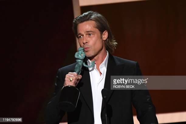Actor Brad Pitt accepts the awards for best Male actor in a supporting role during the 26th Annual Screen Actors Guild Awards show at the Shrine...