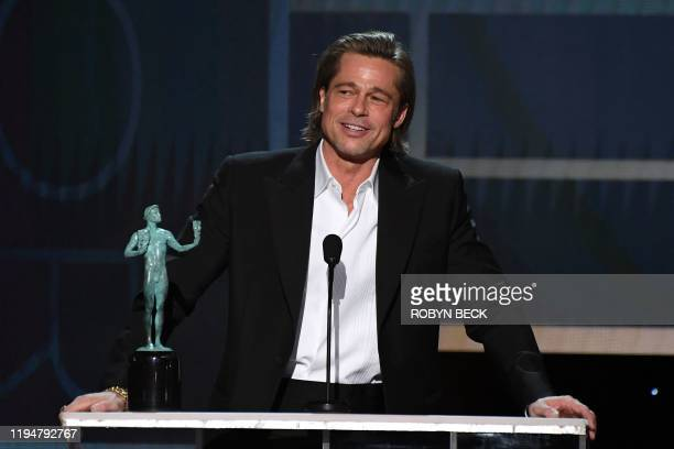 US actor Brad Pitt accepts the awards for Outstanding Performance by a Male Actor in a Supporting Role during the 26th Annual Screen Actors Guild...