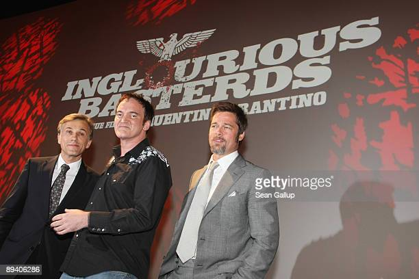 Actor Brad Pitt actor Christoph Waltz and director Quentin Tarantino attend the German premiere of Inglourious Basterds on July 28 2009 in Berlin...