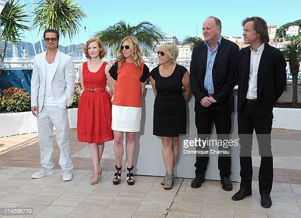 Actor Brad Pitt actress Jessica Chastain producer Dede Gardner producer Sarah Green producer Grant Hill and producer Bill Pohland attend The Tree Of...