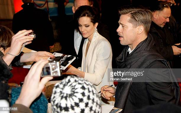 Actor Brad Pitt and actress and girlfriend Angelina Jolie attend the premiere of 'The Curious Case Of Benjamin Button' at the CineStar on January 19...