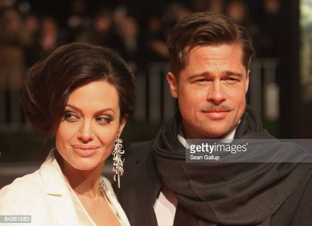 Actor Brad Pitt and actress Angelina Jolie arrive for the German premiere of The Curious Case of Benjamin Button at the Sony Center CineStar on...
