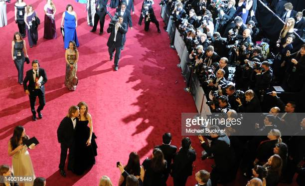 Actor Brad Pitt and actress Angelina Jolie arrive on the red carpet of the 84th Annual Academy Awards at the Kodak Theatre on February 26 2012 in...
