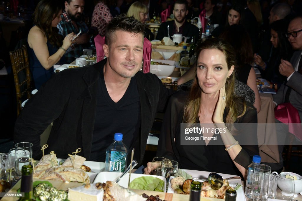 Actor Brad Pitt and actress Angelina Jolie attend the 2014 Film Independent Spirit Awards at Santa Monica Beach on March 1, 2014 in Santa Monica, California.