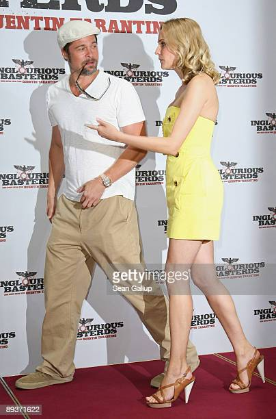 Actor Brad Pitt and actress Diane Kruger attend the photocall for 'Inglourious Basterds' at the Adlon Hotel on July 28 2009 in Berlin Germany
