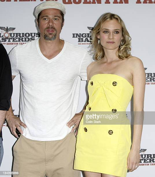 Actor Brad Pitt and actress Diane Kruger attend the photocall of 'Inglourious Basterds' at Hotel Adon on July 28 2009 in Berlin Germany