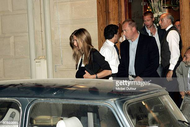 Actor Brad Pitt and actress Jennifer Aniston leave the restaurant Le Stresa after arriving May 24 2004 in Paris France Pitt arrived in Paris to film...