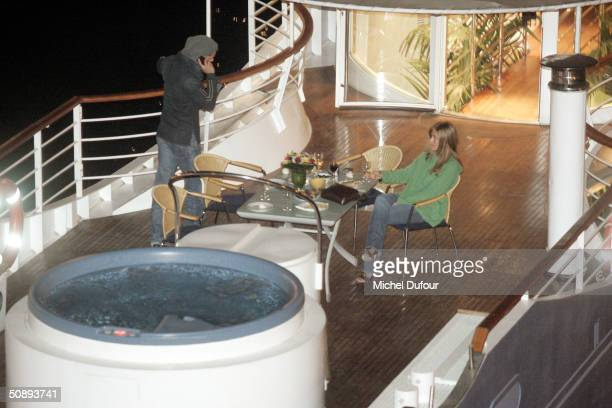 Actor Brad Pitt and actress Jennifer Aniston take a ride on board the 'Josephine' after arriving May 24 2004 in Paris France Pitt arrived in Paris to...