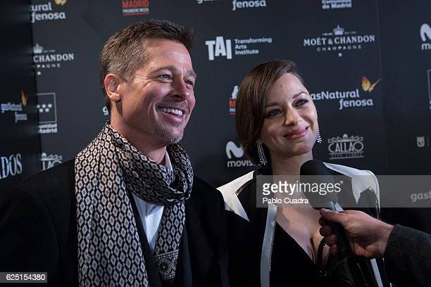 Actor Brad Pitt and Actress Marion Cotillard attend the Madrid premiere of the Paramount Pictures title 'Allied' at Callao City Lights on November 22...