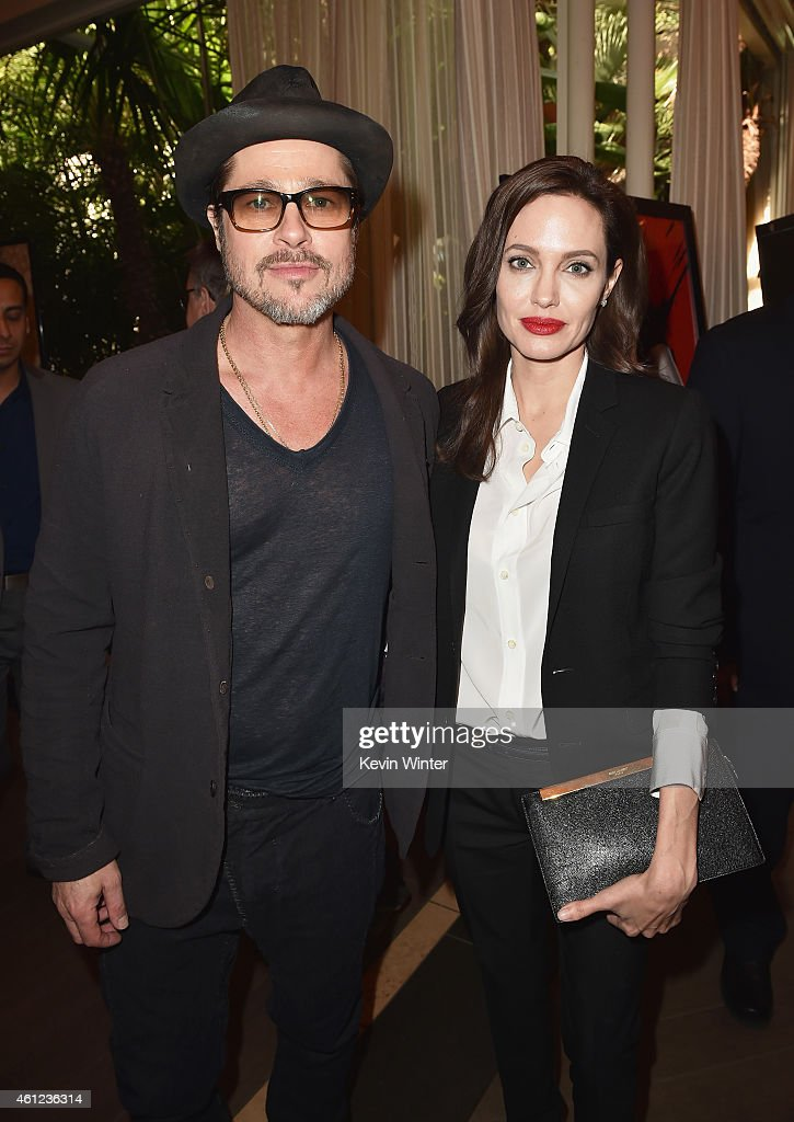 Actor Brad Pitt (L) and actress/director Angelina Jolie attend the 15th Annual AFI Awards at Four Seasons Hotel Los Angeles at Beverly Hills on January 9, 2015 in Beverly Hills, California.