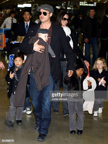 Actor Brad Pitt and Angelina Jolie arrive at Narita International Airport with their children Pax Thien Knox Zahara and Shiloh on January 27 2009 in...