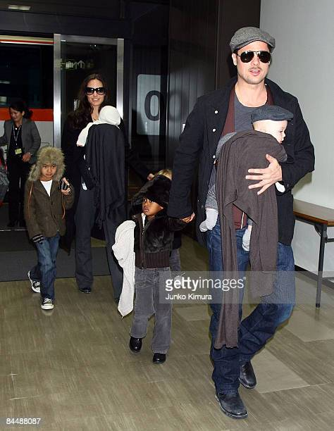 Actor Brad Pitt and Angelina Jolie arrive at Narita International Airport with their children Maddox Vivienne Zahara and Knox on January 27 2009 in...