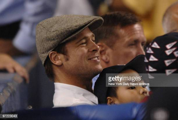 Actor Brad Pitt and Angelina Jolie's son Maddox at a New York YankeesSeattle Mariners game at Yankee Stadium
