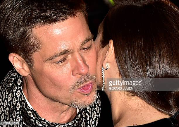 US actor Brad Pitt and French actress Marion Cotillard interact as they arrive to attend the Spain premiere of the film 'Allied' in Callao City...