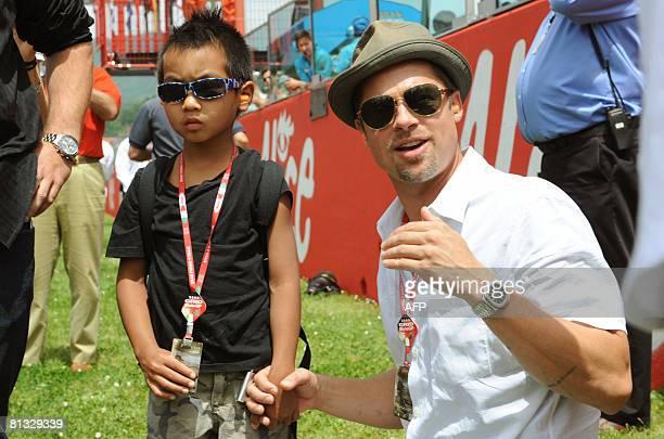 US Actor Brad Pitt and his son Maddox JoliePitt pose during the Italian Grand Prix at Mugello on June 1 2008 AFP PHOTO / Claudio Giovannini