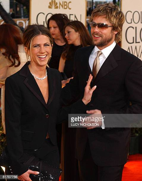 US actor Brad Pitt and his wife actress Jennifer Aniston arrive at the 59th Annual Golden Globe Awards in Beverly Hills CA 20 January 2002 AFP...