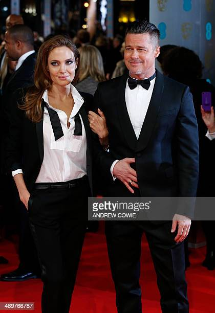 US actor Brad Pitt and his wife Angelina Jolie arrive on the red carpet for the BAFTA British Academy Film Awards at the Royal Opera House in London...