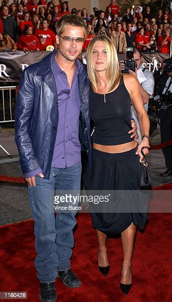 Actor Brad Pitt and his wife Jennifer Aniston attend the premiere of the film Rock Star September 4 2001 in Westwood CA