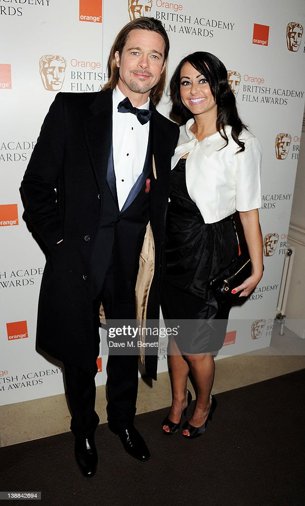 Actor Brad Pitt (L) and Sonja Stephen arrive at the Orange British Academy Film Awards 2012 at The Royal Opera House on February 12, 2012 in London, England.