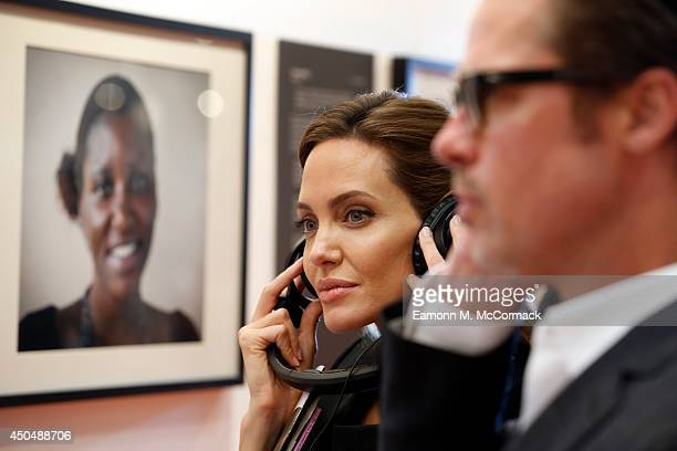 Actor Brad Pitt and UN Special Envoy and actress Angelina Jolie listen to testimonies of victims of violence as they attend the Global Summit to End...