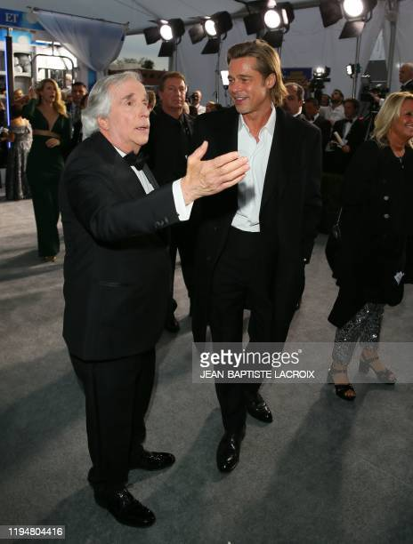 US actor Brad Pitt and US actor Henry Winkler arrive for the 26th Annual Screen Actors Guild Awards at the Shrine Auditorium in Los Angeles on...
