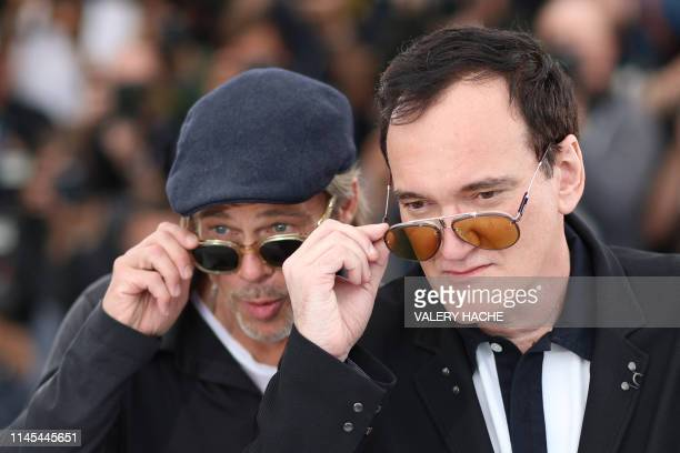 TOPSHOT US actor Brad Pitt and US film director Quentin Tarantino pose during a photocall for the film Once Upon a Time in Hollywood at the 72nd...