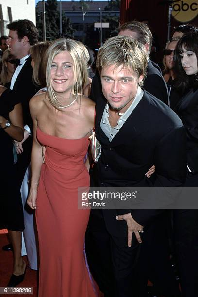 Actor Brad Pitt and wife actress Jennifer Aniston arrive at the 52nd 2000 Primetime Emmy Awards on September 10 2000 at the Shrine Auditorium in Los...
