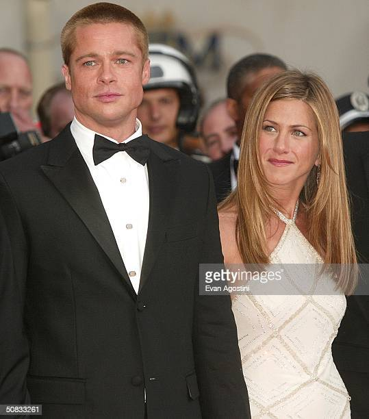 Actor Brad Pitt and wife actress Jennifer Aniston attend the World Premiere of the epic movie Troy at Le Palais de Festival on May 13 2004 in Cannes...