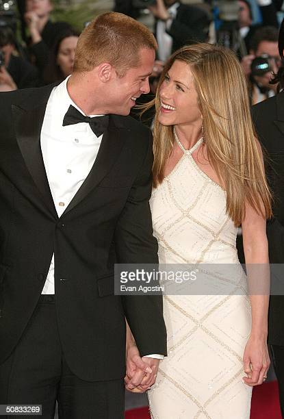 "Actor Brad Pitt and wife actress Jennifer Aniston attend the World Premiere of the epic movie ""Troy"" at Le Palais de Festival on May 13, 2004 in..."