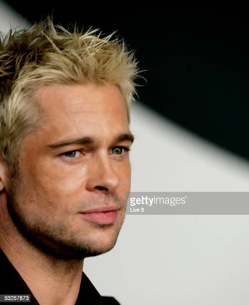 Actor Brad Pitt appears on stage at Live 8 London in Hyde Park on July 2 2005 in London England The free concert is one of ten simultaneous...