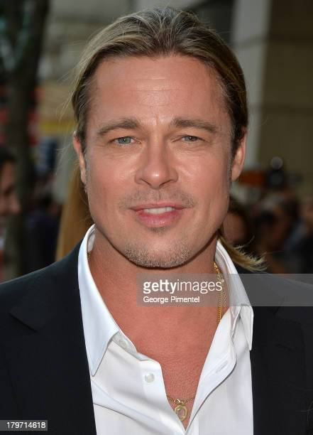 Actor Brad Pitt arrives at the 12 Years A Slave Red Carpet during the 2013 Toronto International Film Festival at Princess of Wales Theatre on...