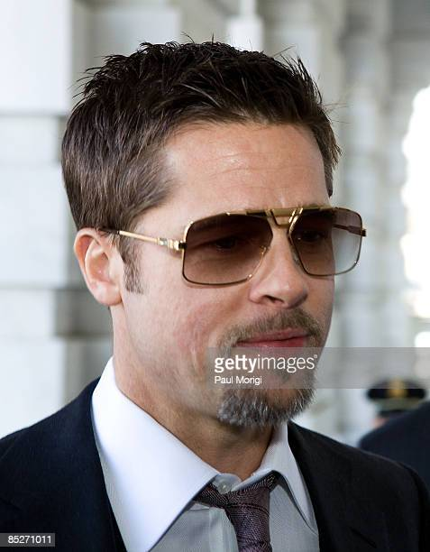Actor Brad Pitt arrives at The US Capitol Building on his way to a Make it Right project press conference in the Speaker's Balcony Hallway in The...