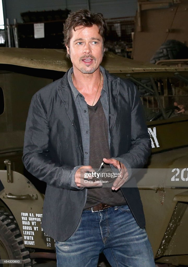 Actor Brad Pitt arrives for a photocall for the film 'Fury' at Bovington Tank Museum on August 28, 2014 in Bovington, England. Columbia Pictures celebrated the upcoming film Fury with the films stars, Brad Pitt, Logan Lerman, and Jon Bernthal, as well as the films writer-director David Ayer, producer Bill Block, and costume designer Owen Thornton at Bovington Tank Museum today. Fury will be released on 24 October 2014 in the UK and 17 October 2014 in the United States.