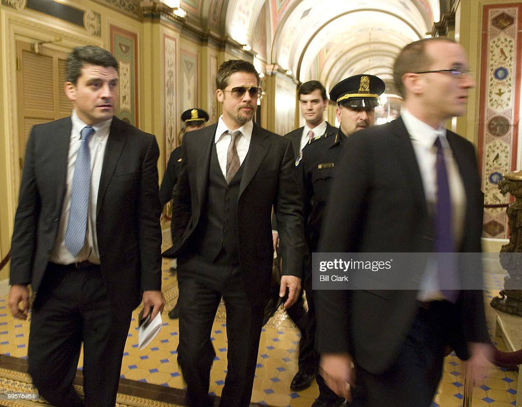 Actor Brad Pitt arrives in the U.S. Capitol to discuss his Make It Right Foundation with Senate Majority Leader Harry Reid on Thursday, March 5, 2009. The foundation's mission is to redevelop New Orleans' Lower 9th Ward with affordable and sustainable housing following Hurricane Katrina.