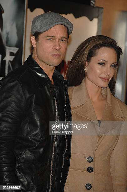Actor Brad Pitt arrives with girlfriend and actress Angelina Jolie at the premiere of 'Beowulf' held at The Village Theater in Westwood