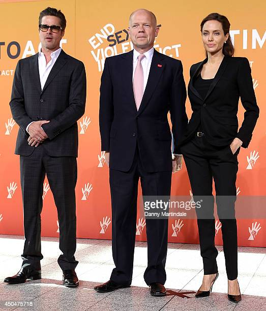 Actor Brad Pitt, Britain's Foreign Secretary William Hague and US actress and UN special envoy Angelina Jolie attend the Global Summit to end Sexual...
