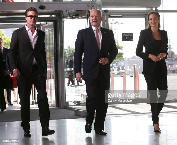 Actor Brad Pitt, Britain's Foreign Secretary William Hague and US actress and UN special envoy Angelina Jolie attends the Global Summit to end Sexual...