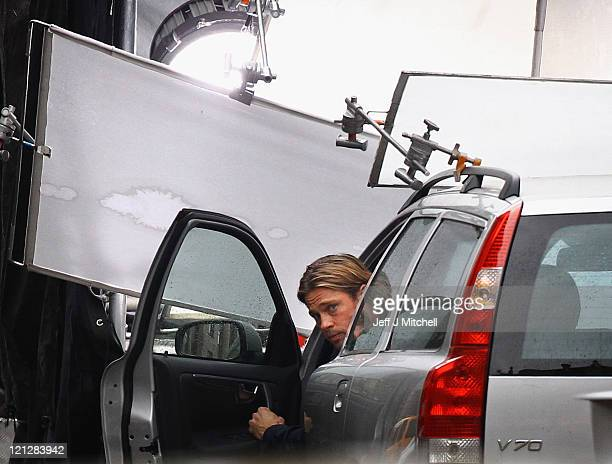 Actor Brad Pitt films a scene from 'World War Z' in Glasgow City centre on August 17, 2011 in Glasgow, Scotland. The film which is set in...