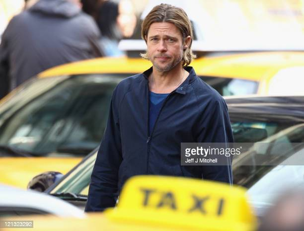 Actor Brad Pitt films a scene from 'World War Z' in Glasgow City centre on August 18, 2011 in Glasgow, Scotland. The film, which is set in...