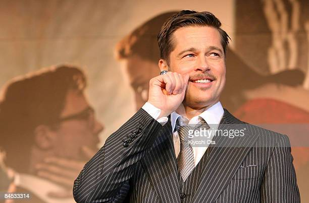 Actor Brad Pitt gestures as he attends 'The Curious Case of Benjamin Button' Japan Premiere at Roppongi Hills on January 29 2009 in Tokyo Japan The...