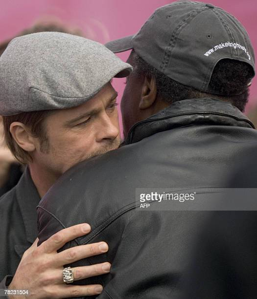 US actor Brad Pitt greets Robert Green during a press conference 03 December 2007 in the Lower 9th Ward of New Orleans Louisiana on Pitt's plans to...