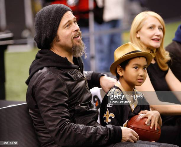 Actor Brad Pitt his son Maddox JoliePitt and actress Patricia Clarkson sit on the bench on the sidelines during warm ups prior to the New Orleans...