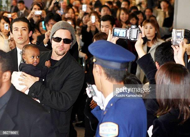 Actor Brad Pitt holds Zahara Marley Jolie as they arrive at the New Tokyo International Airport on November 27 2005 in Narita Japan Pitt and actress...
