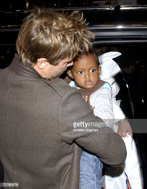 Actor Brad Pitt holds Zahara while leaving a toy store on 57th Street December 8 2006 in New York City