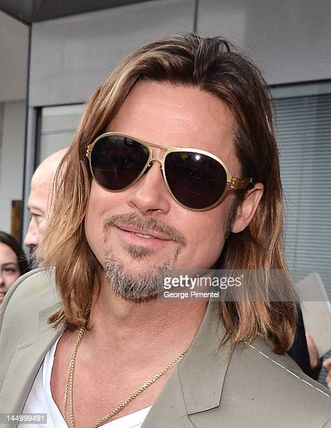 Actor Brad Pitt leaves the 'Killing Them Softly' Photocall during the 65th Annual Cannes Film Festival at Palais des Festivals on May 22 2012 in...