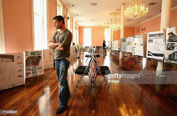 Actor Brad Pitt looks at entries for the Global Green sustainable design architecture competition during a trip to lobby government officials to...