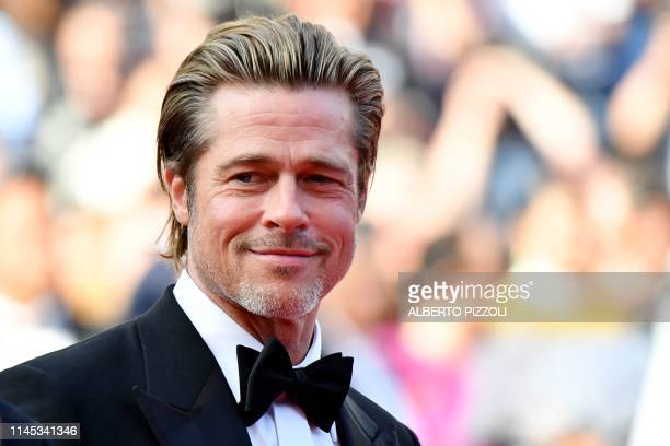 """Actor Brad Pitt poses as he arrives for the screening of the film """"Once Upon a Time... In Hollywood"""" at the 72nd edition of the Cannes Film Festival..."""