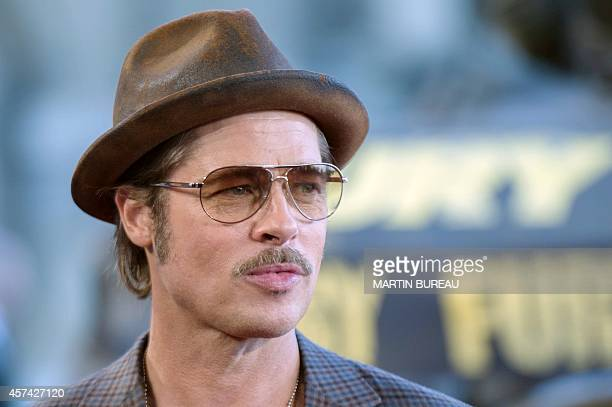 US actor Brad Pitt poses during a photocall for the film Fury on October 18 2014 in Paris AFP PHOTO / MARTIN BUREAU