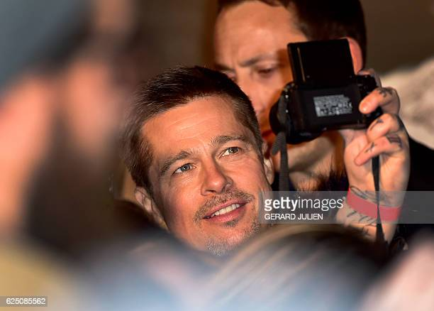 US actor Brad Pitt poses for a selfie as they arrive for the premiere of the film 'Allied' on November 22 2016 in Madrid JULIEN